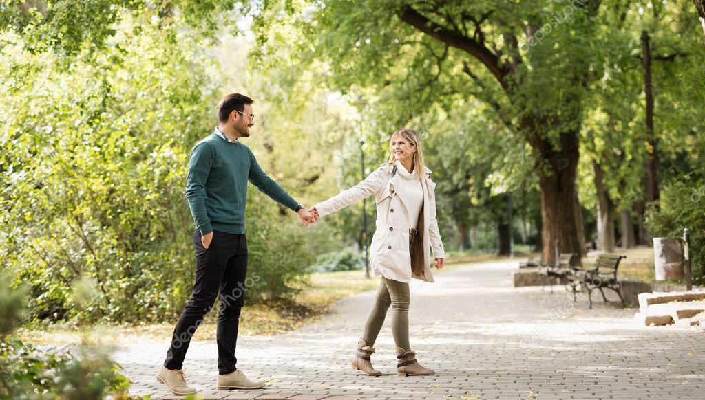 Happy couple walking in park