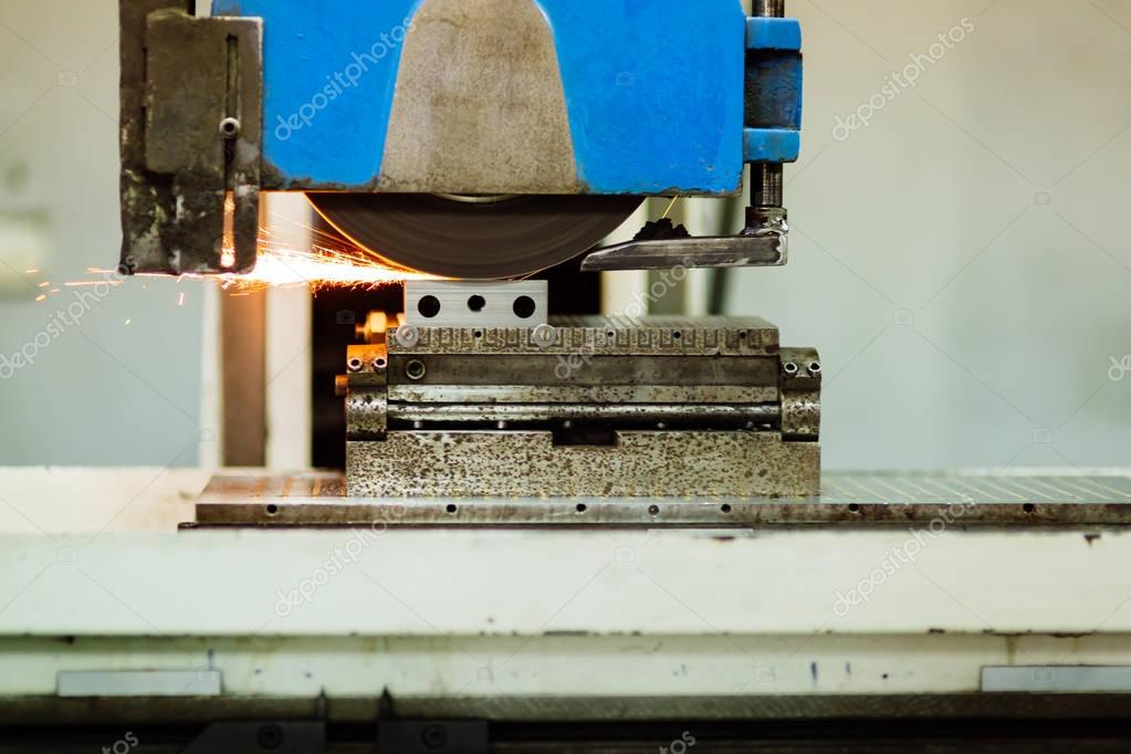 Polishing surface of metal in factory