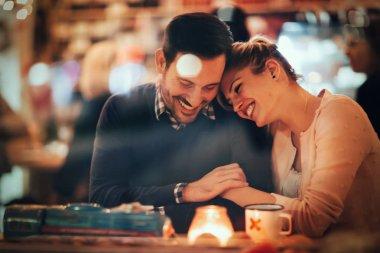 Romantic couple dating in pub