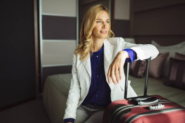 Traveling woman staying in hotel room