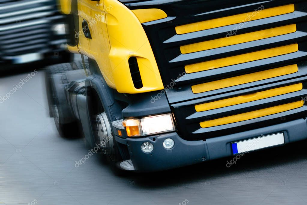 Trucks being driven on road