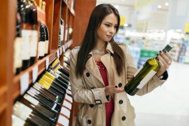 Beautiful woman buying wines