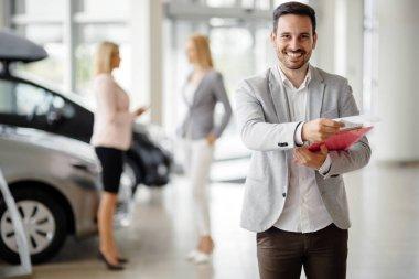 Salesperson at car dealership