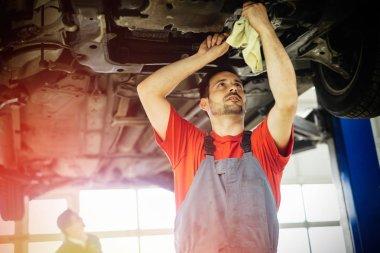 Car mechanics working on car maintenance stock vector