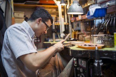 Jeweler working on workbench