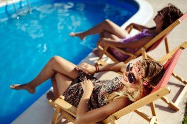 Women sunbathing in summer
