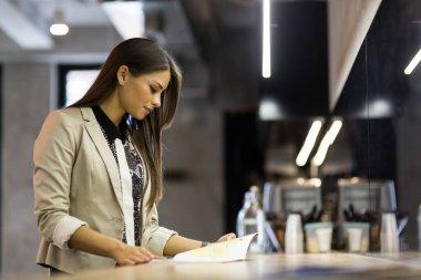woman reading menu on bar
