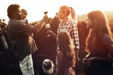 Winemaker family in vineyard