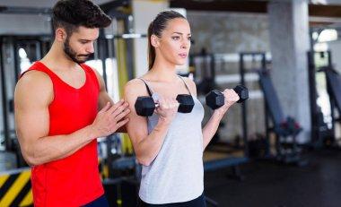 trainer helping woman reach goals