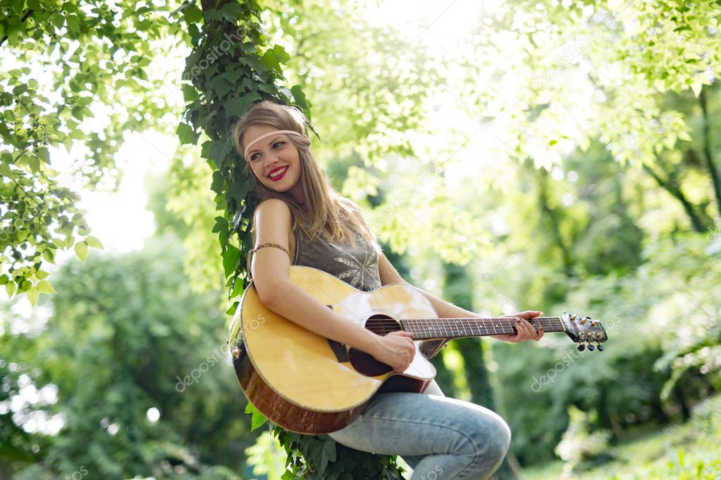woman playing guitar in nature