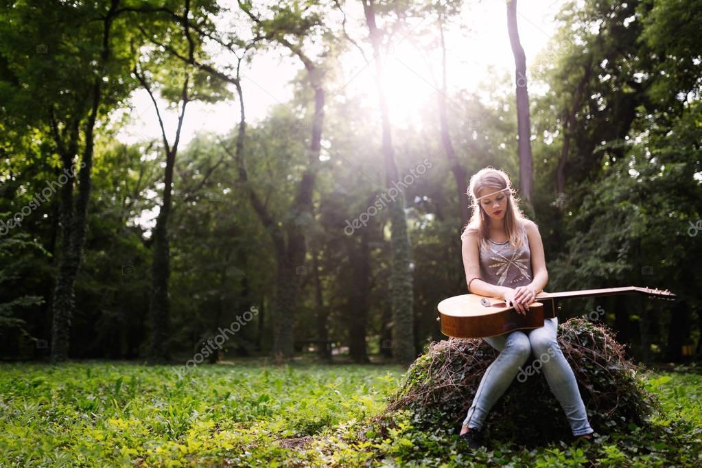 Heartbroken woman with guitar