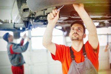Car mechanics at service center