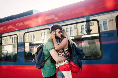 Couple separating for time at train station