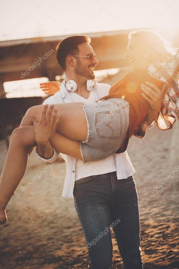 couple in love having fun at beach