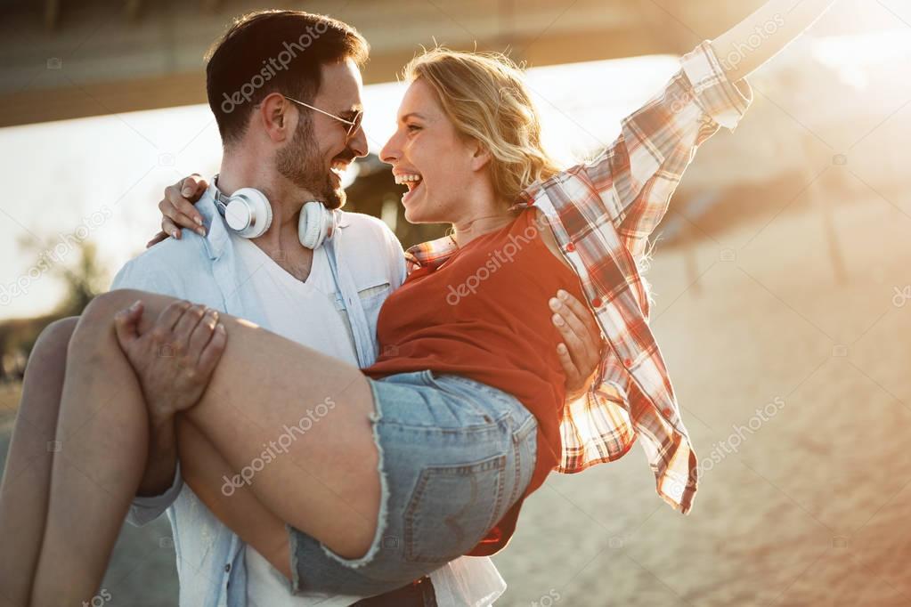 couple in love having fun at beach