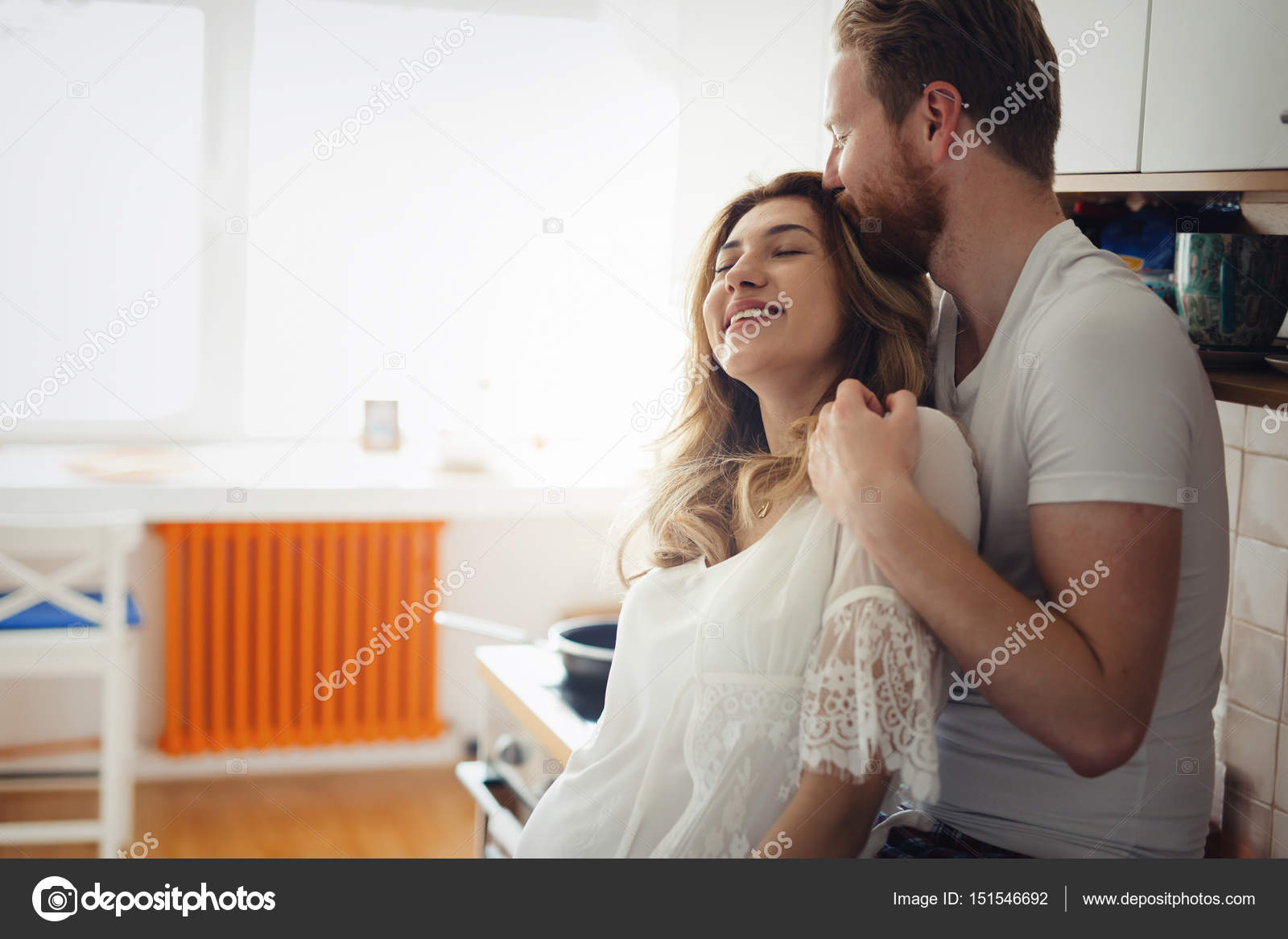 Romantic couple in love in kitchen — Stock Photo © nd3000 #151546692