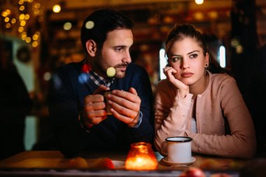 Sad young couple having conflict and relationship problems