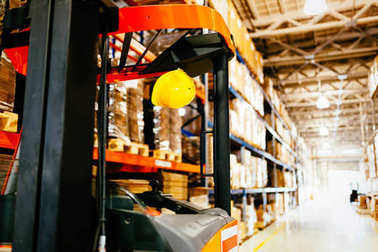 Picture of forklift machine parked in storage warehouse