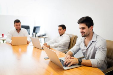 Picture of businesspeople working on computers in modern office