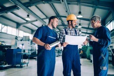 Team Of Engineers Having Discussion In Metal Industries Factory