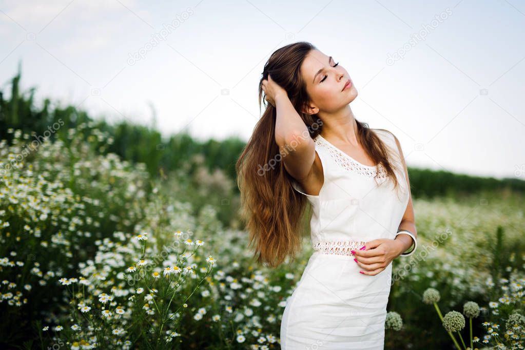 Young beautiful happy woman spending time in nature