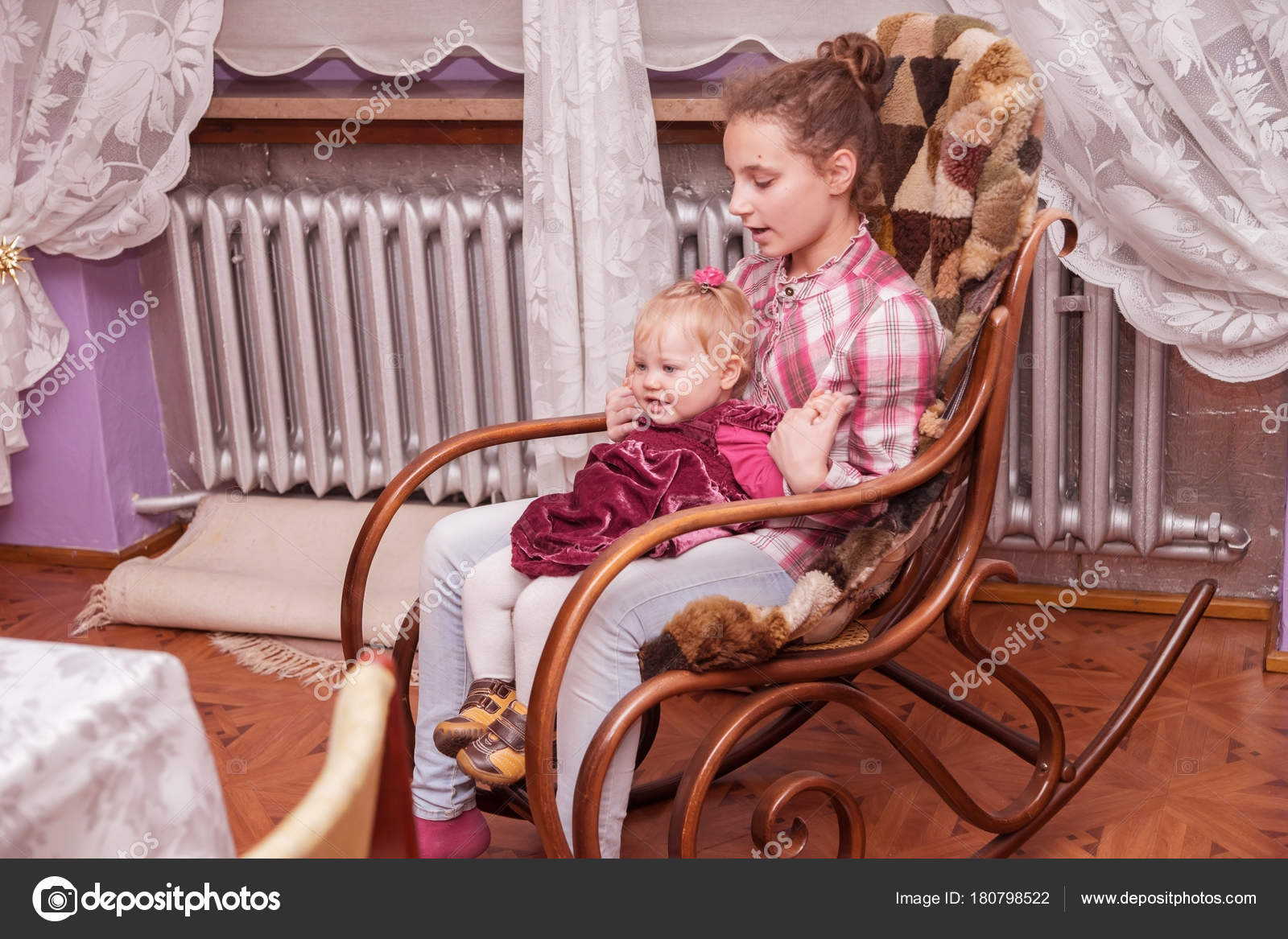 Baby Girl Sitting In Rocking Chair At Big Sister S Lap Photo By Svianola