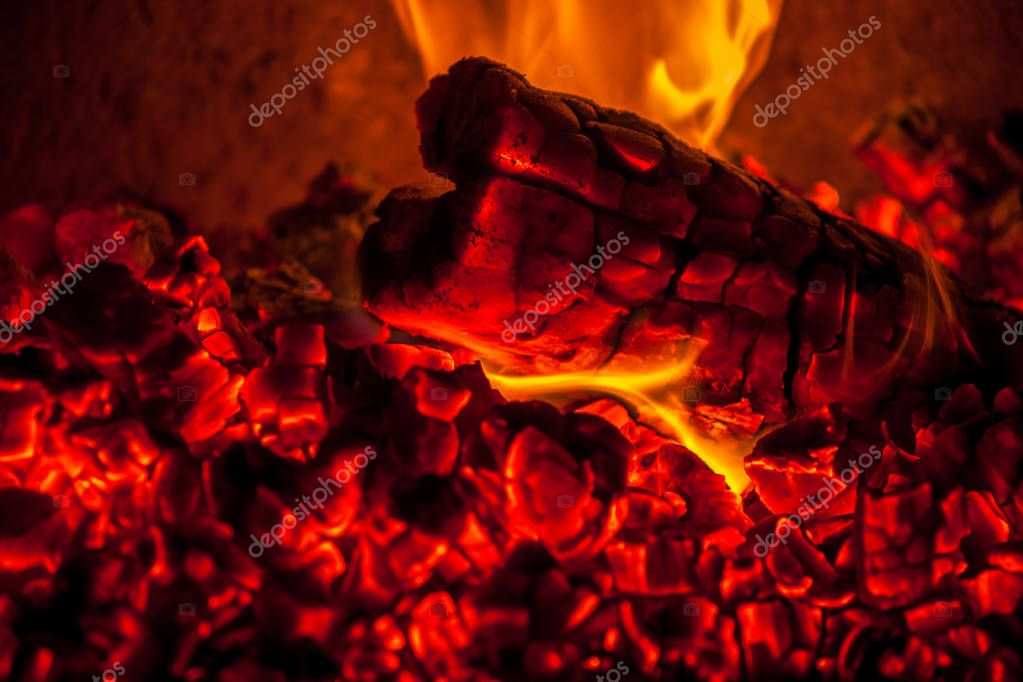 A fire burns in a fireplace