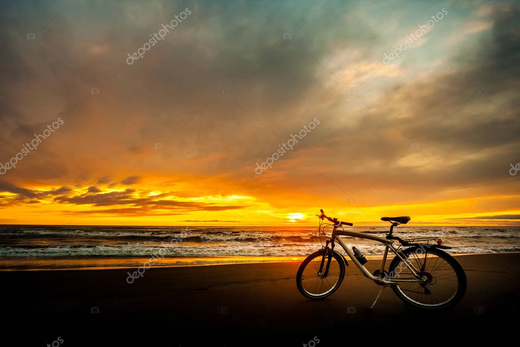 Tourist bike on the coast of the sea at sunset time
