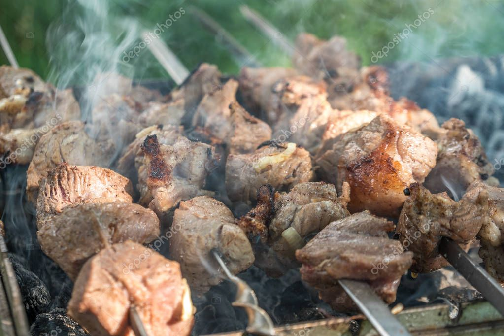 Georgian mtsvadi (Shashlik) preparation. Smoking shashlik on the