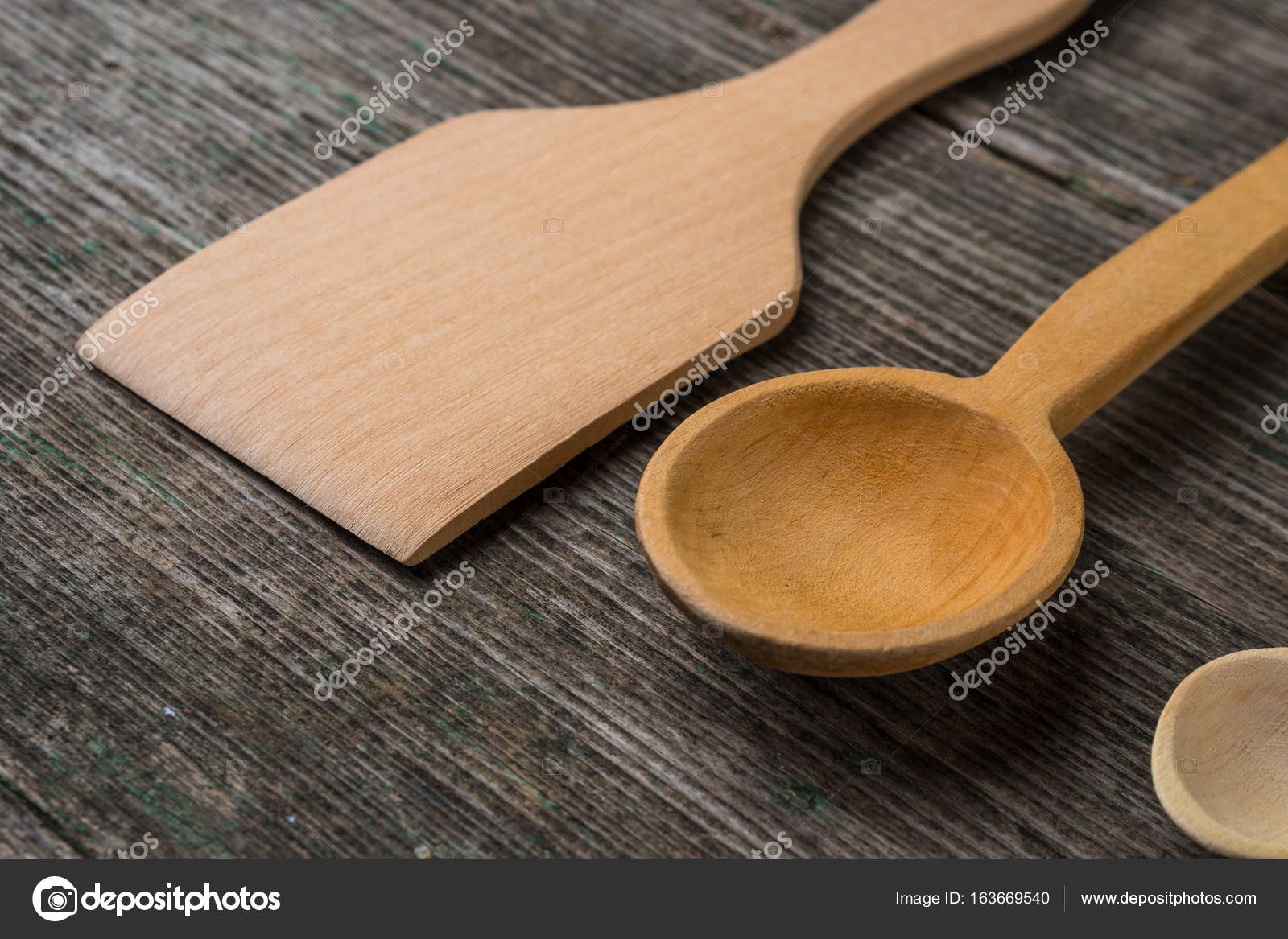 Astounding Handmade Wooden Spoons On A Wooden Board Kitchen Tools Download Free Architecture Designs Grimeyleaguecom