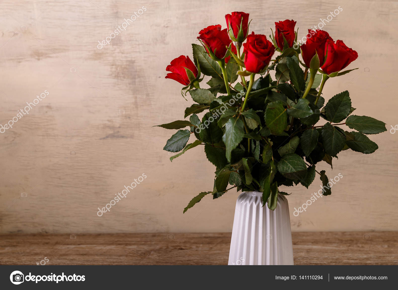 Bouquet of red roses in a vase love design stock photo bouquet of red roses in a vase on wood background 8 march concept romantic love design fresh natural flowers photo by tanyastock floridaeventfo Choice Image