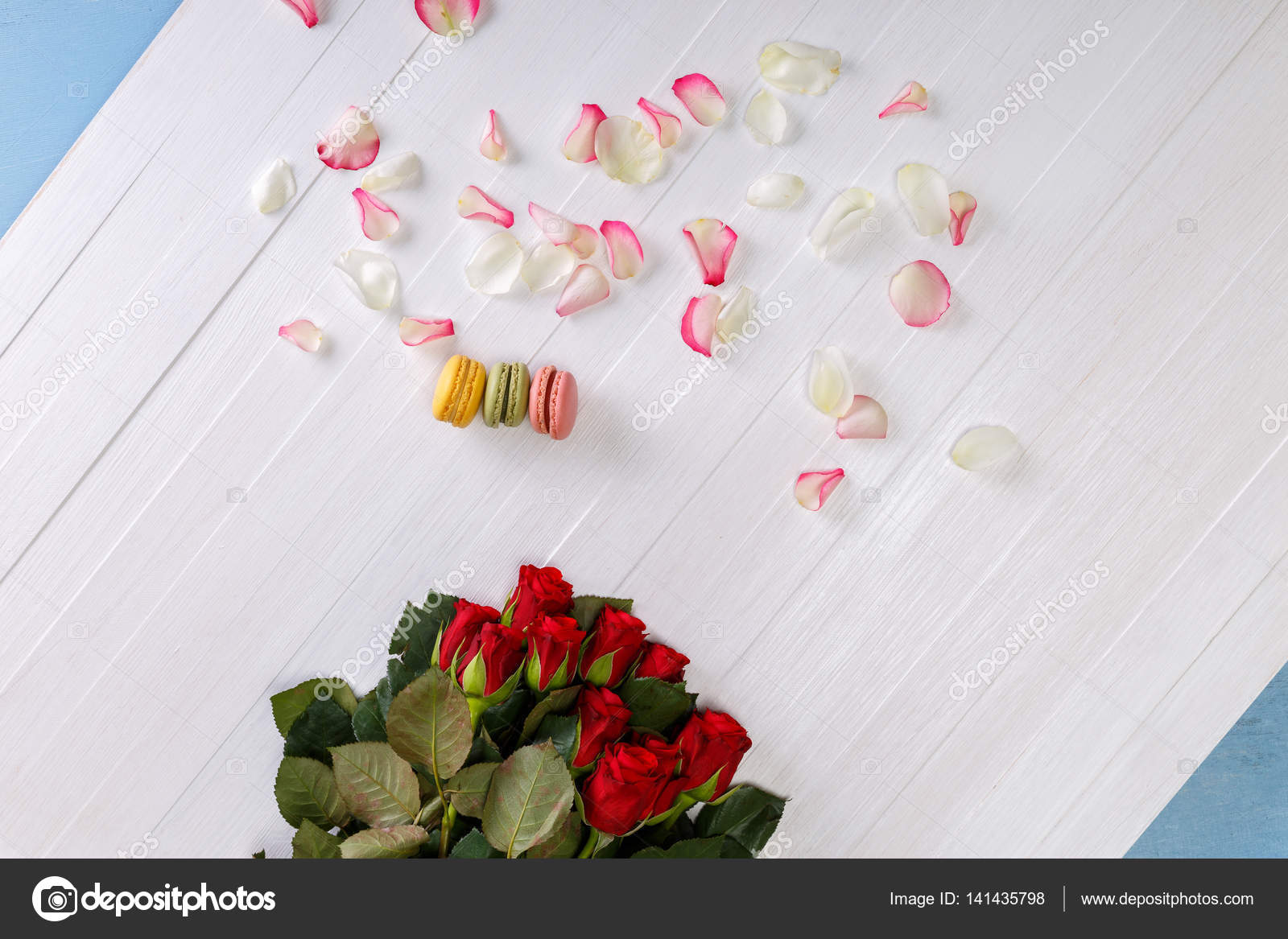 Macaroon cakes with bouquet of red roses stock photo tanyastock macaroon cakes with bouquet of red roses stock photo izmirmasajfo