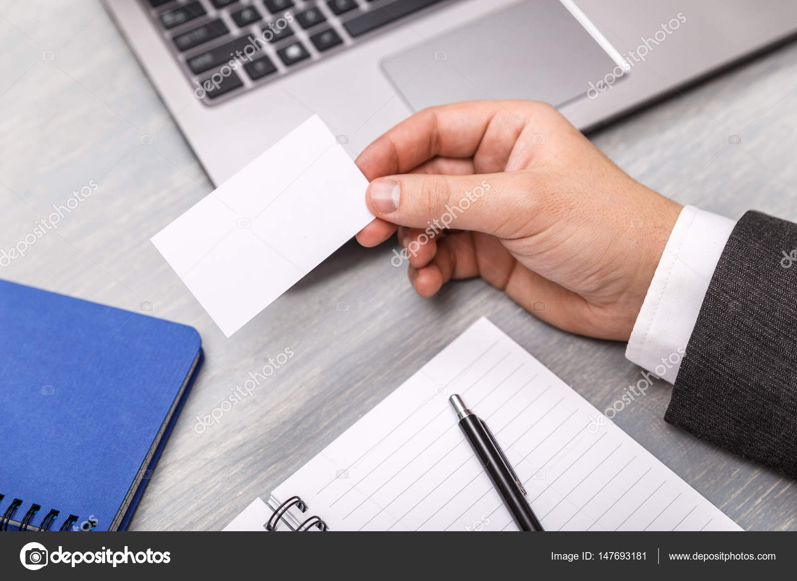 hand hold blank business card design mockup businessman holding visiting card business branding template person in suit and white shirt