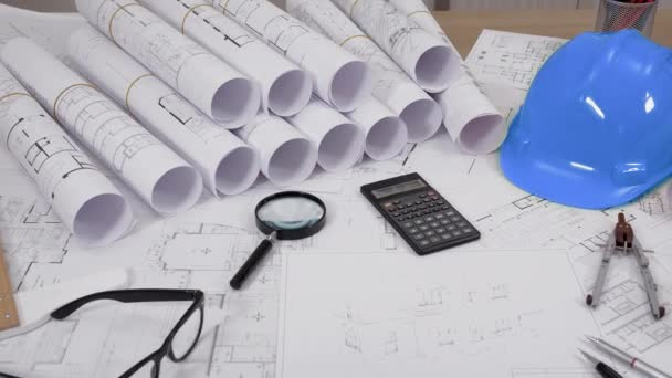 Close-up shot of architectural drawings on table
