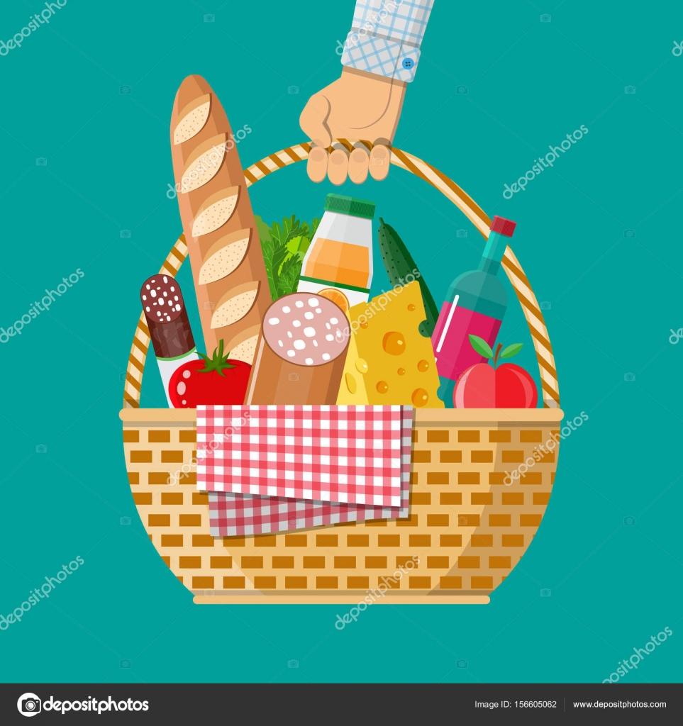 Mano sostiene la cesta de picnic de mimbre llena de productos ...