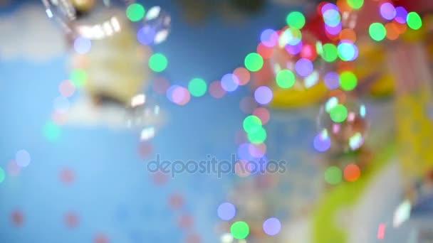 Mýdlové bubliny na barevné rozostření pozadí.