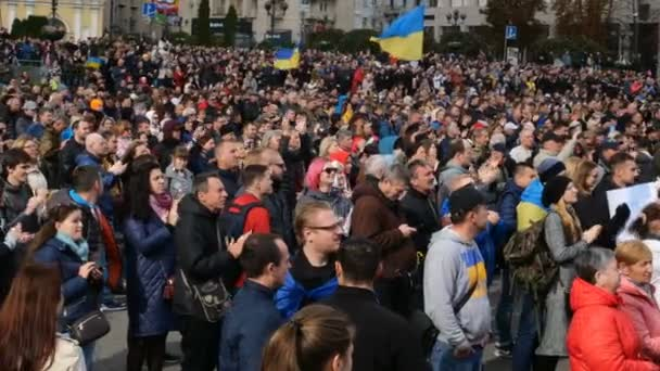 Kiev, Ukraine, August 2019: - Large crowd applauds speakers at a protest rally against the authorities on Khreshchatyk, in Kiev, Ukraine.