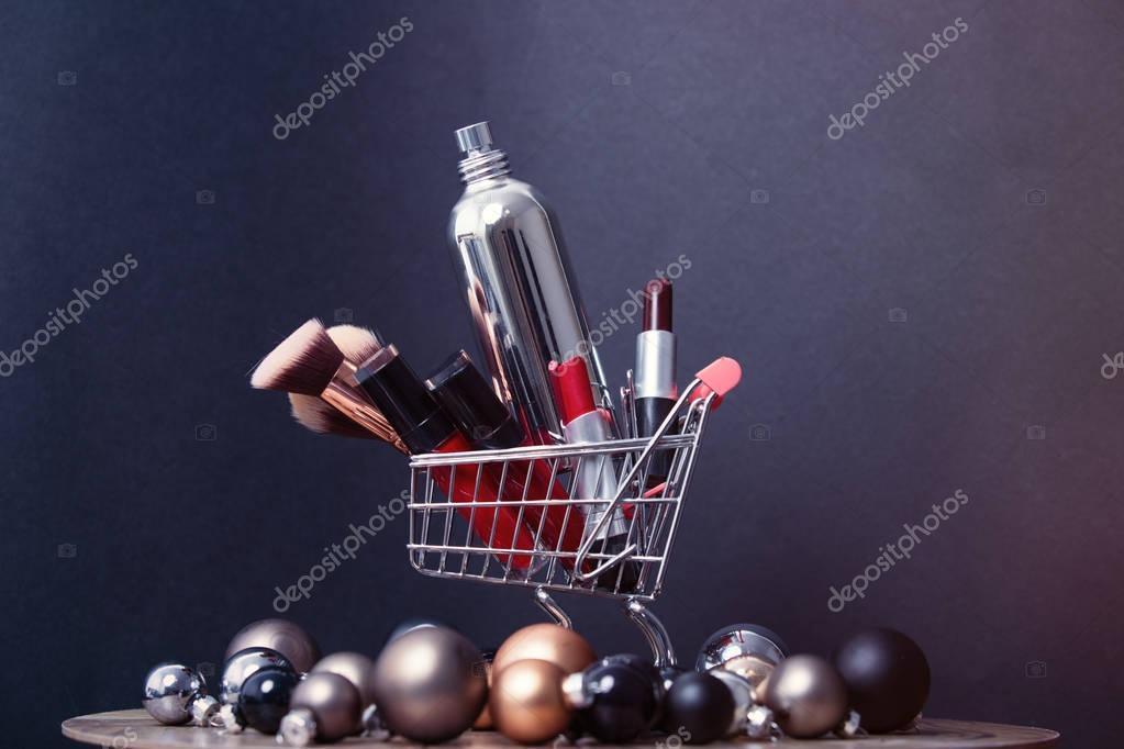 Christmas baubles and makeup lipsticks