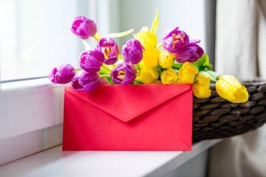 bunch of tulips and envelope
