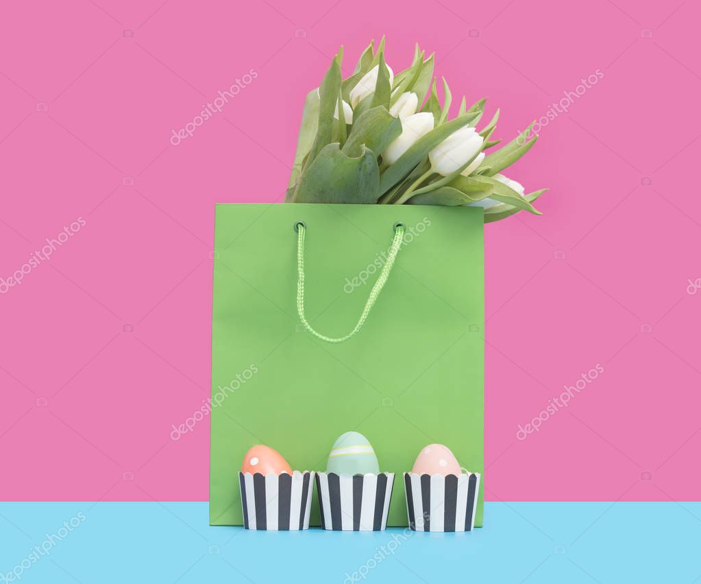 Shopping bag with tulips and easter eggs