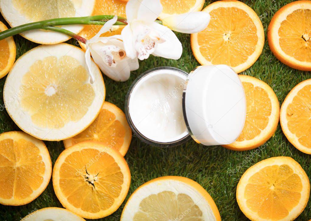 facial cream and orange slices