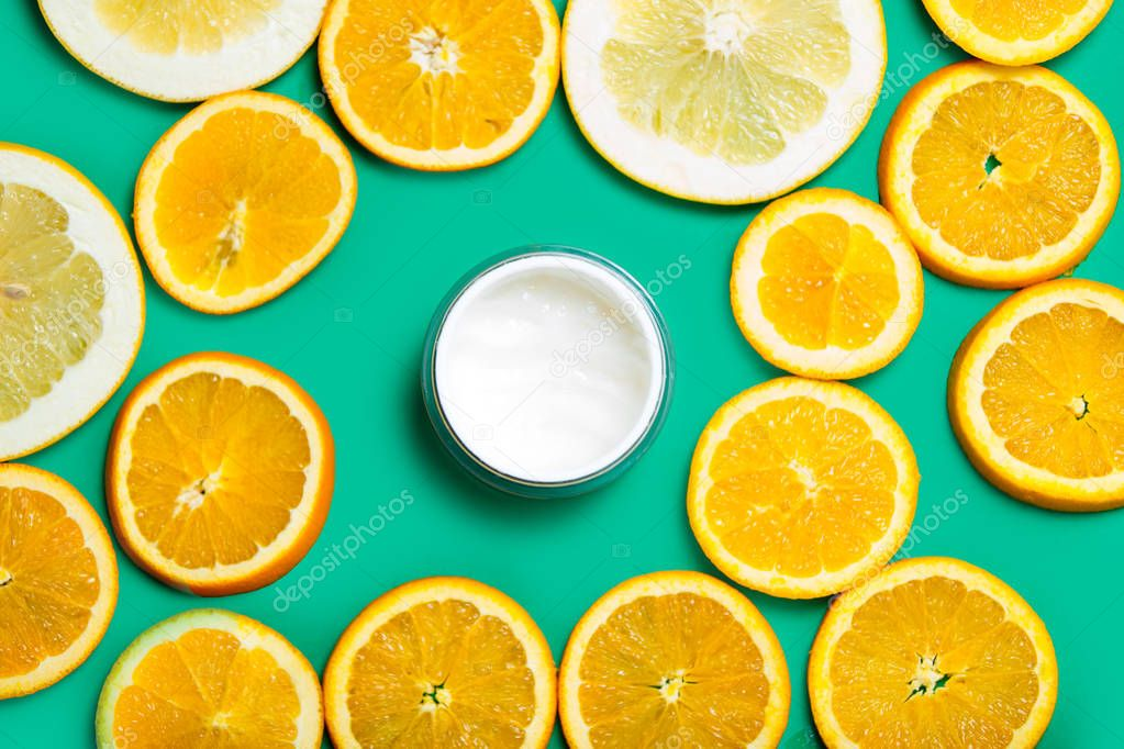 facial cream and orange slices