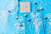 field flowers and gift box