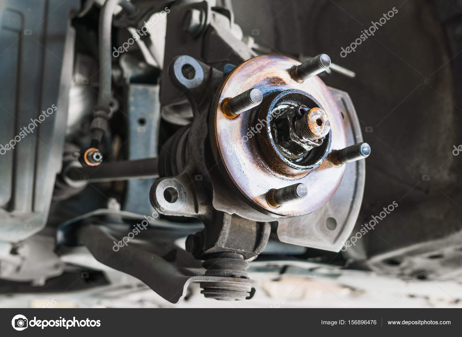 Auto Service Car Disc Brakes Changing Of Lifted Automobile At A Stock Photo