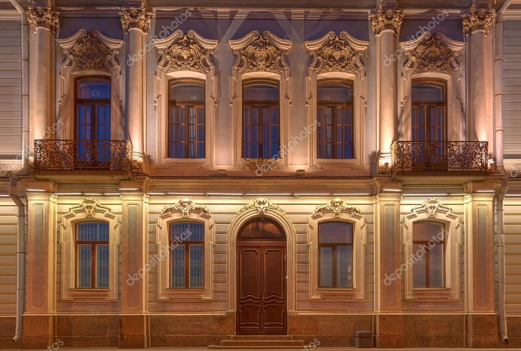 Windows Door And Balconies On Night Facade Of Apartment Building