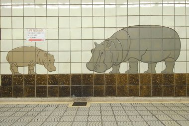 Drawn hippos on tiled wall of subway