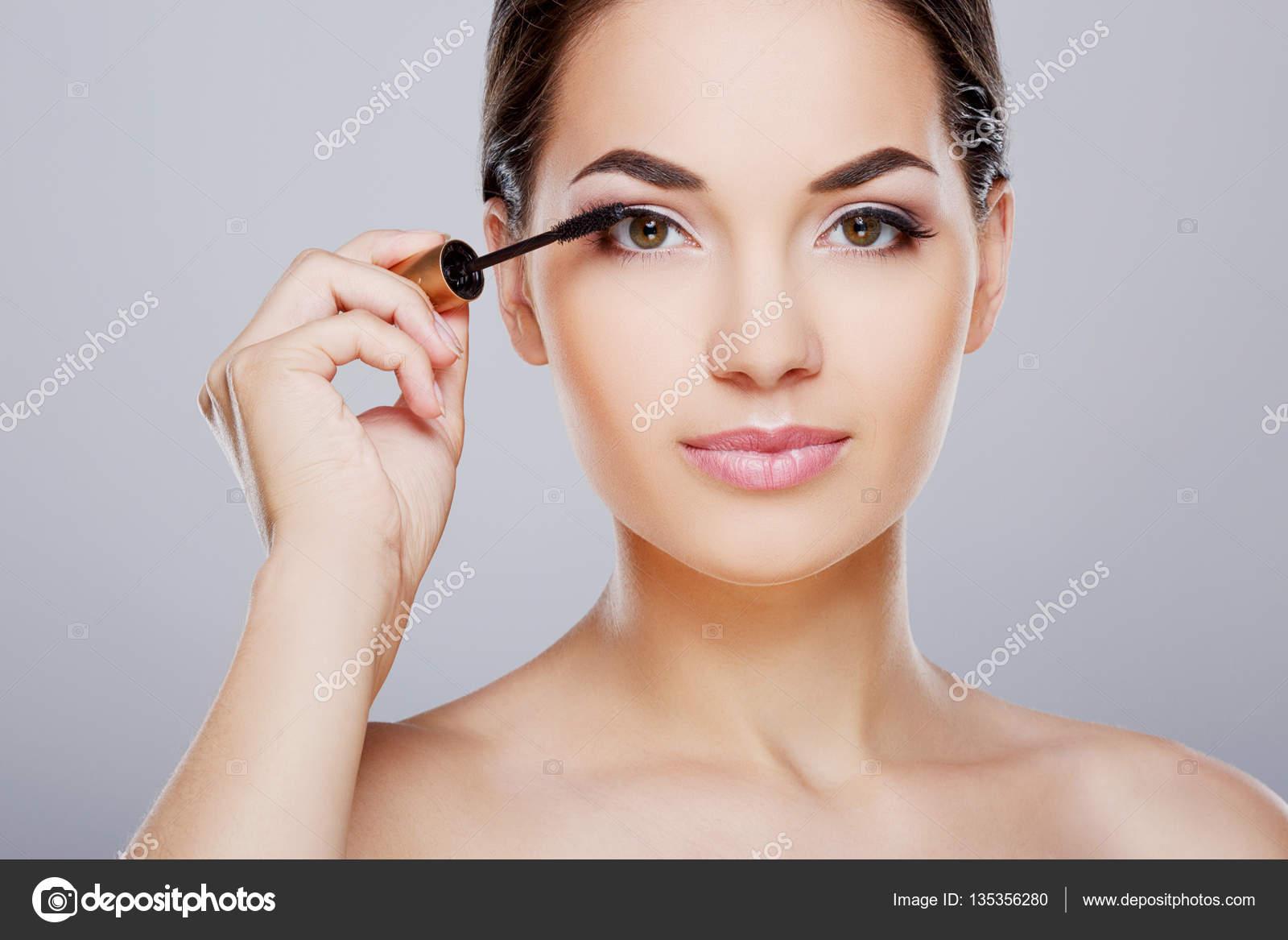 Pretty Model Painting Eyelashes With Mascara Stock Photo