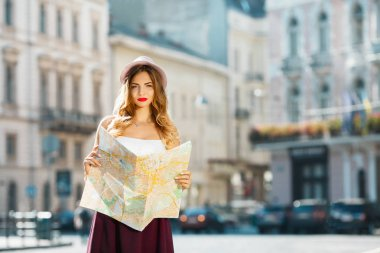 Gorgeous woman holding map