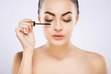 girl doing make up with mascara