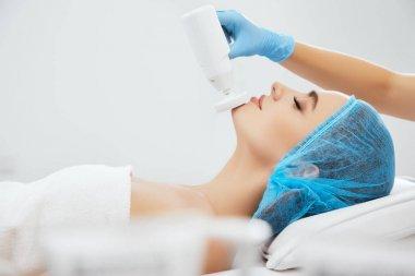 Woman lying on procedure of brossage